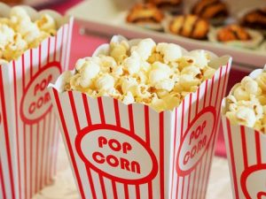 Boxes of popcorn in cinema foyer